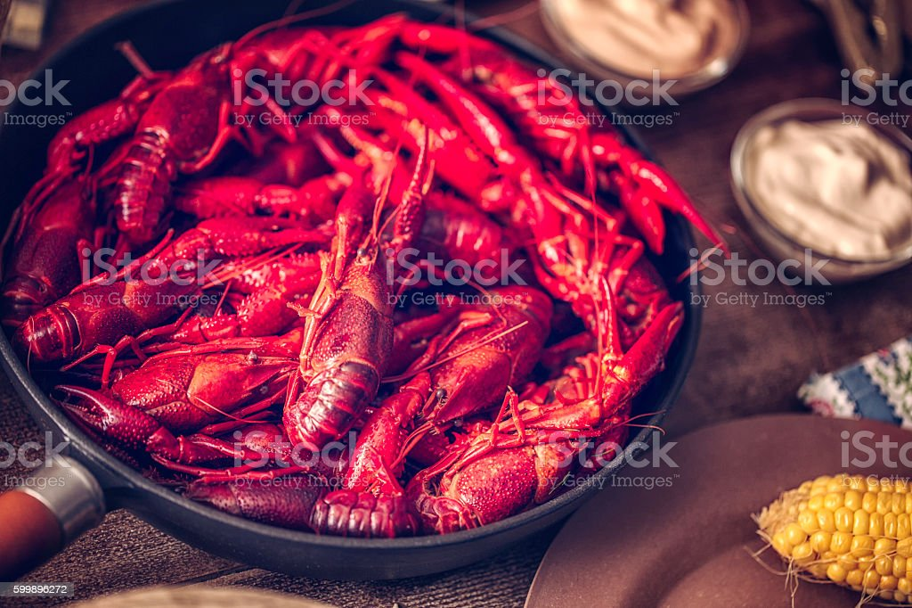 Delicious Boiled Red Crayfish with Sweet Corn, Potatoes and Beer stock photo
