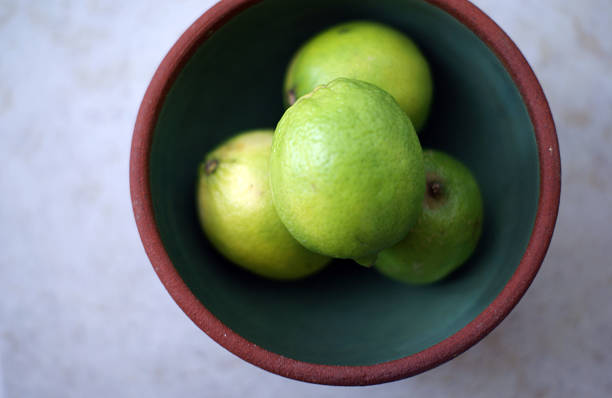 Delicious Bowl of Limes stock photo