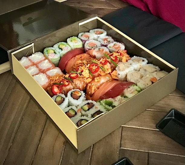 A delicious box of sushi. stock photo