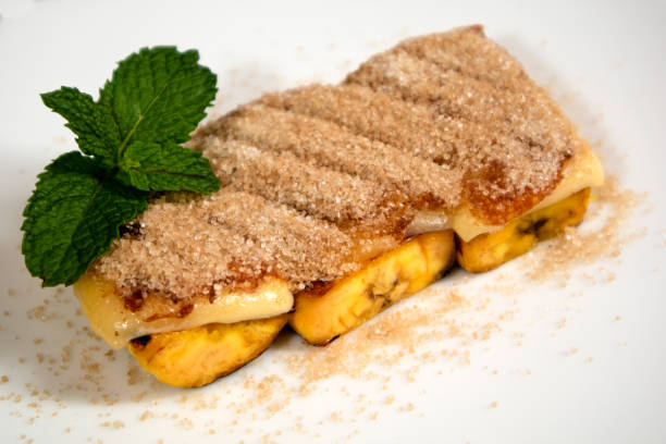 Delicious Brazilian dessert Cartola made with fried bananas, cheese and suggar with cinnamon. stock photo
