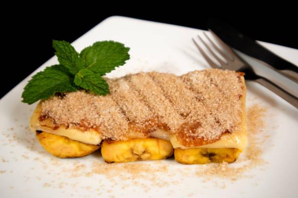 Delicious Brazilian dessert Cartola made with fried bananas stock photo