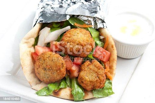 Falafel in pita bread sandwich on white background