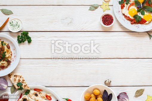 istock Delicious breakfast buffet frame on white wood 646206920
