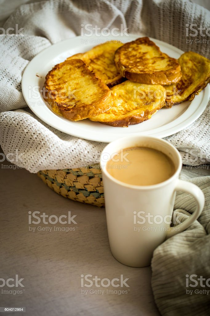 delicious Breakfast in bed with a big sword coffee stock photo