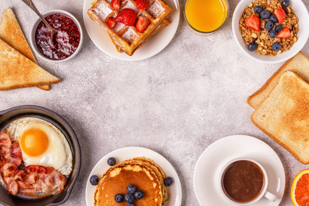 delicious breakfast on a light table. - breakfast stock photos and pictures