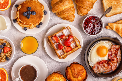 istock Delicious breakfast on a light table. 863444442