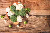 istock Delicious broccoli and cauliflower has a wooden rustic table 465080104