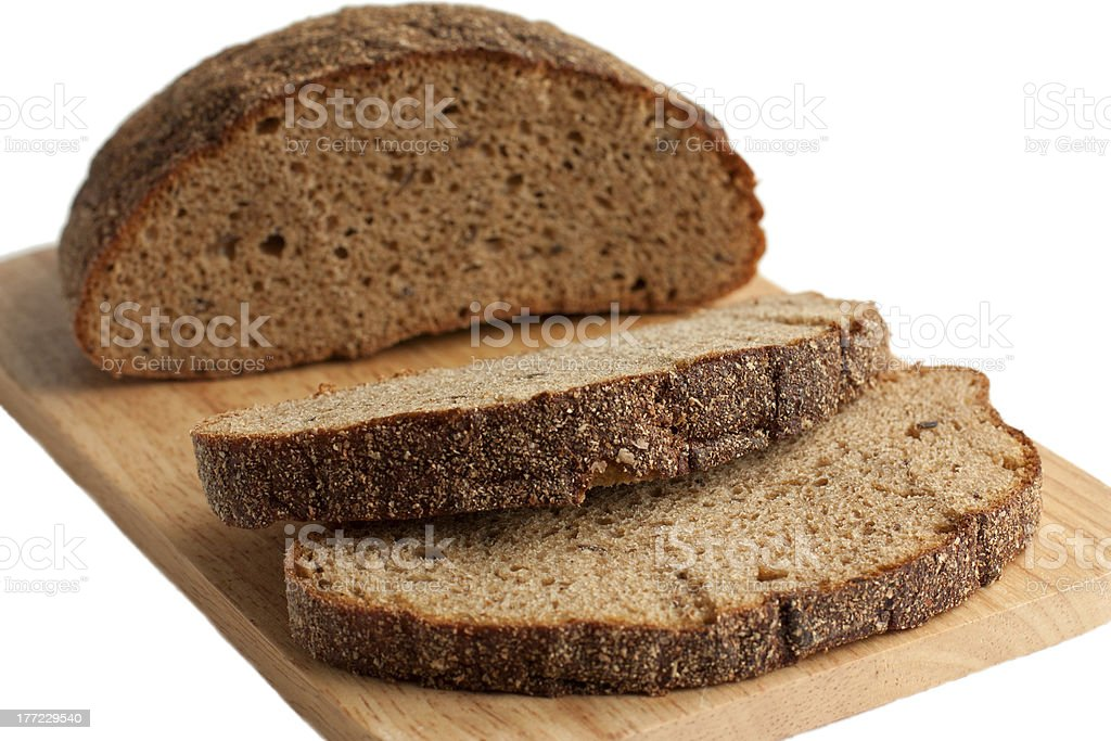 Delicious brown bread on the cutting board royalty-free stock photo