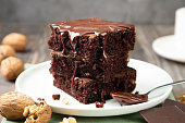 istock Delicious brownies with melted chocolate on a stack 1191431503