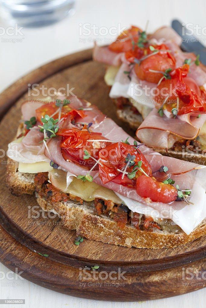 Delicious Bruchetta with ham and tomato royalty-free stock photo