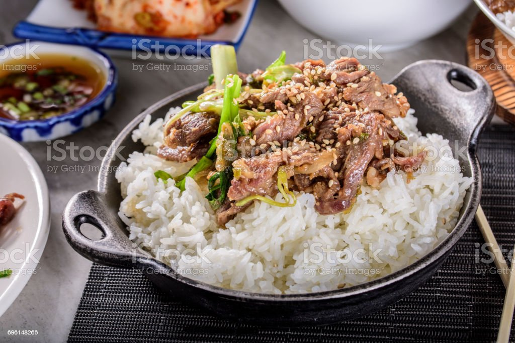 Delicious Bulgogi , Marinated in soy sauce and garlic and ginger,over Steamed Rice stock photo