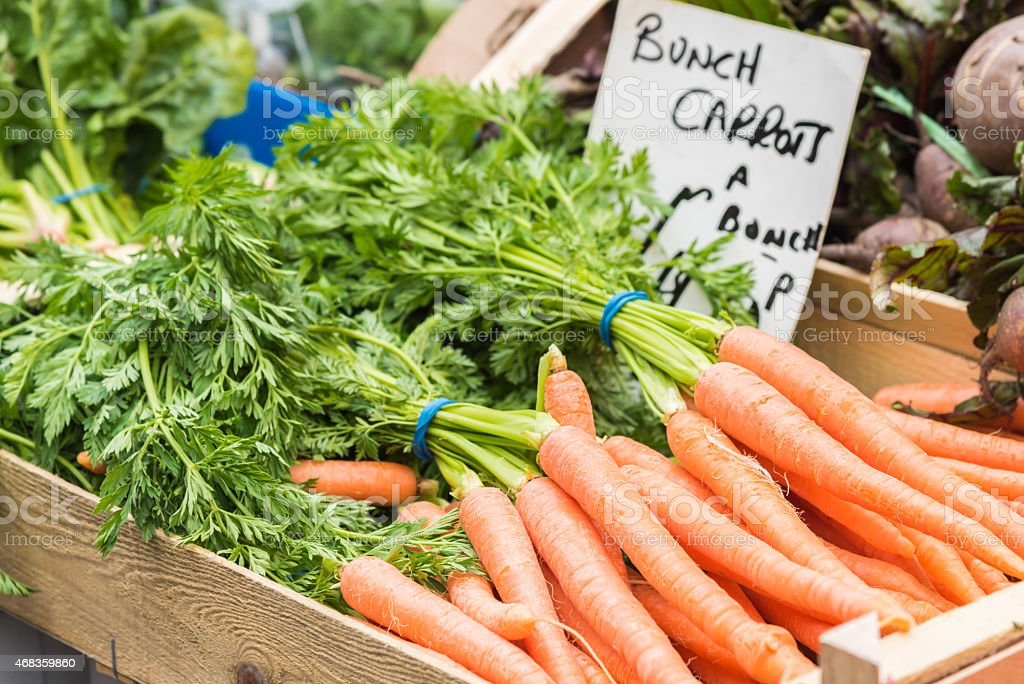 Delicious bunches of healthy carrots on the market place royalty-free stock photo