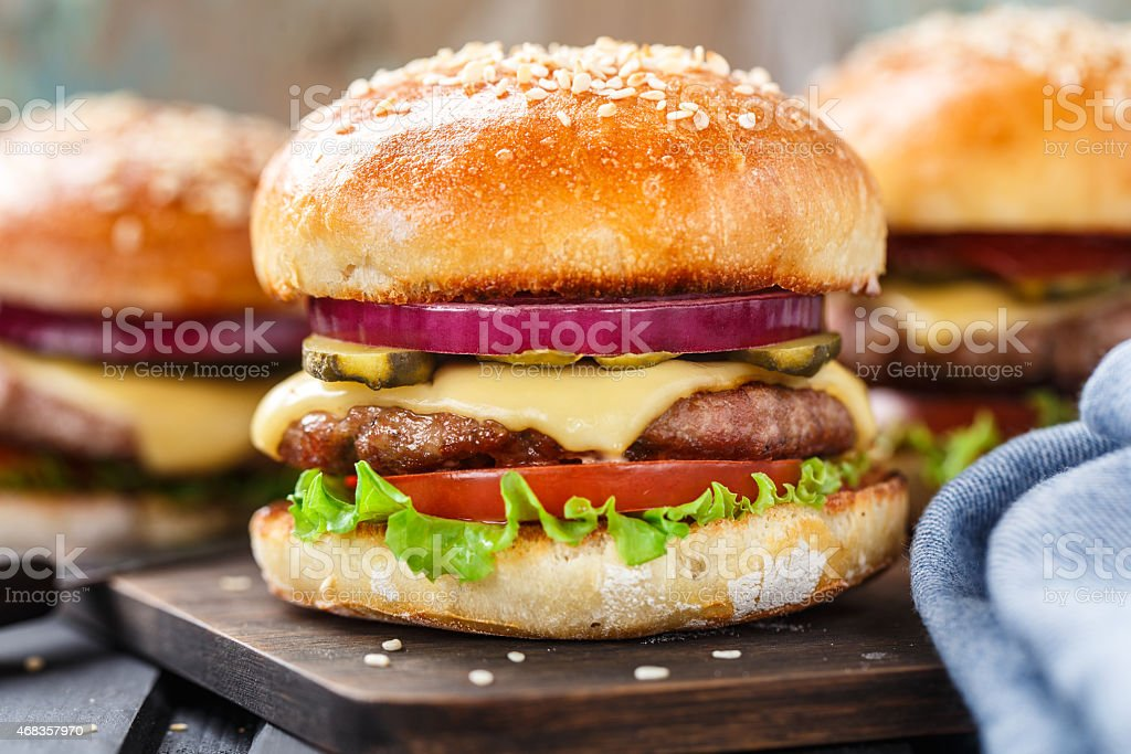 Delicious burger on wooden board royalty-free stock photo
