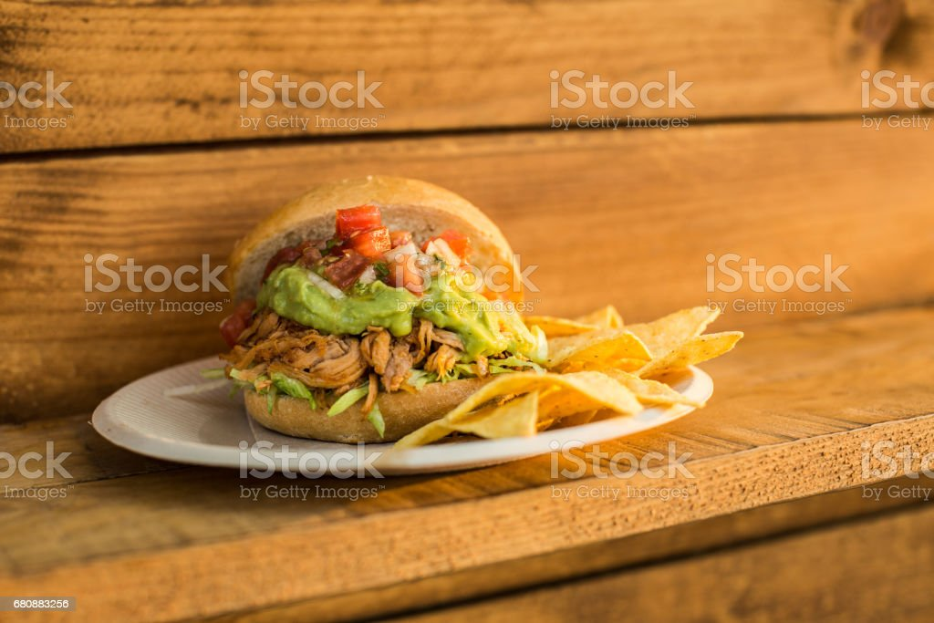 Delicious burger served with chips royalty-free stock photo