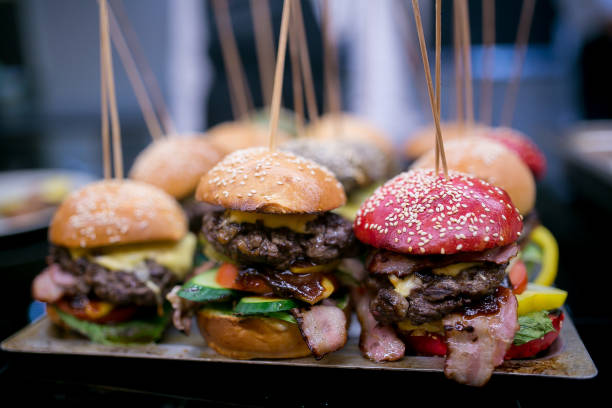 delicious burgers on a tray - sliding stock photos and pictures