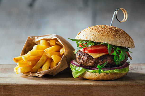 Delicious burgers with beef, tomato, cheese and lettuce stock photo