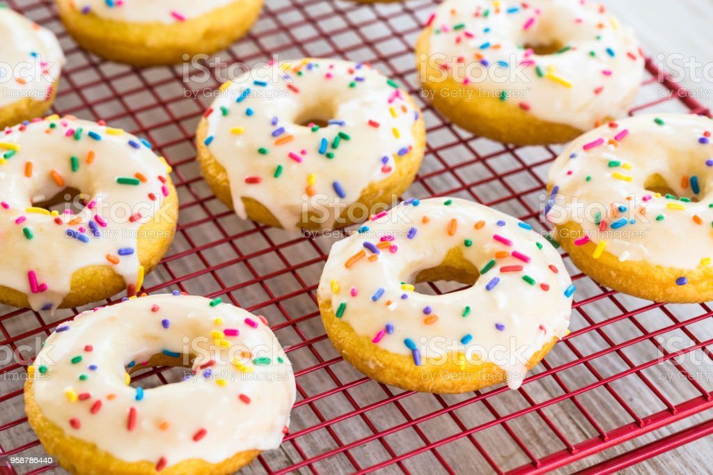 Delicious Cake Donuts On Red Rack stock photo