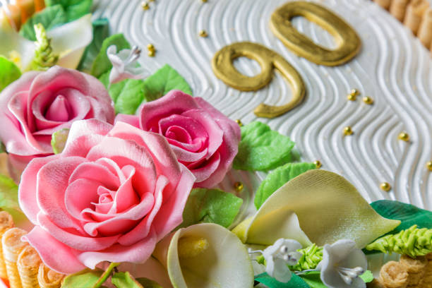 delicious cake with roses, lily, leaves and figures 90 years on light blue wooden table close up with selective focus - number 90 stock photos and pictures