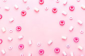 istock Delicious candies and marshmallows on pink background. 1180337730