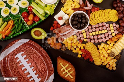 Delicious charcuterie board and veggie with dipping for Super Bowl football game.