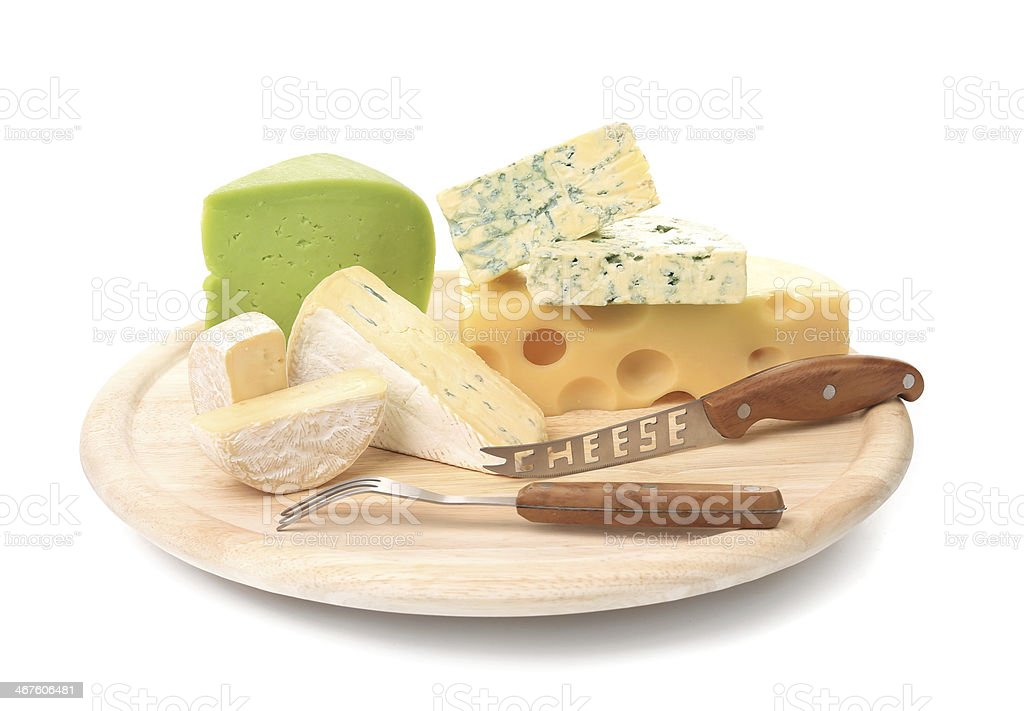 Delicious cheese and knife on wood platter. royalty-free stock photo