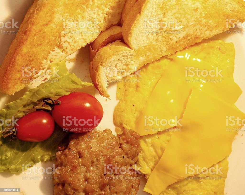 Delicious Cheese Egg Omelet,Sausage Patty and Buttered Toast stock photo