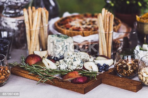 istock Delicious cheese plate on wedding reception 637397438
