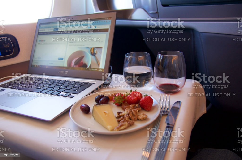 delicious cheese, red wine and working on a laptop in Business Class an new Airbus A350 - foto stock