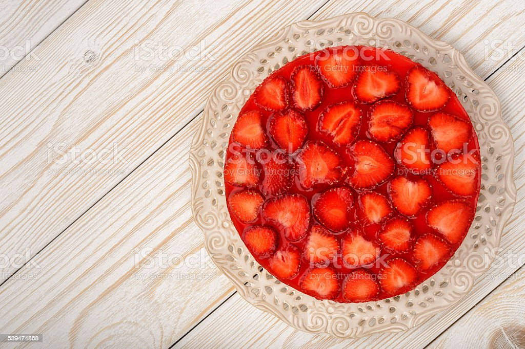 Delicious cheesecake with strawberry mousse, strawberry jelly and strawberries. stock photo