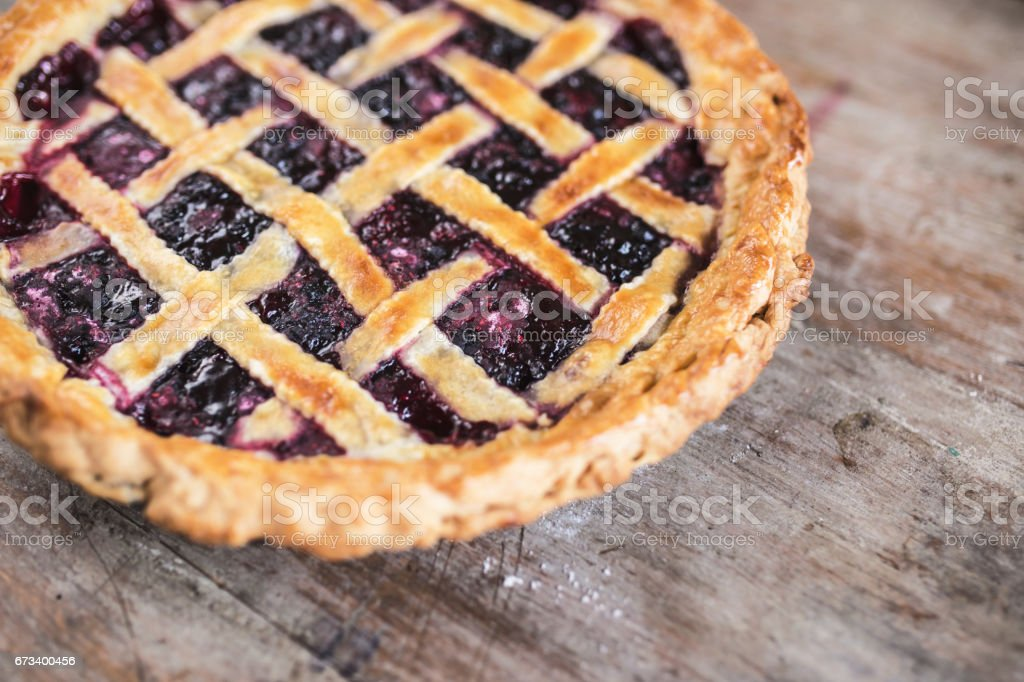 Delicious Cherry Pie with a Flaky Crust On Wooden Table stock photo