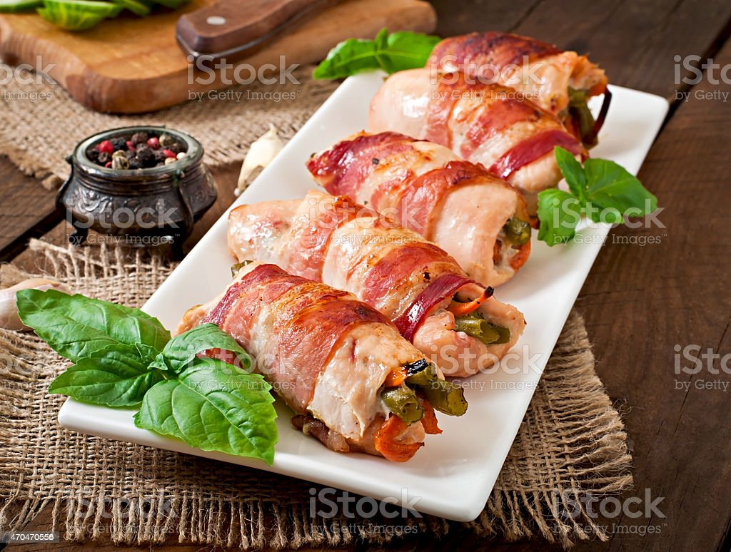 Delicious chicken rolls stuffed with green beans stock photo