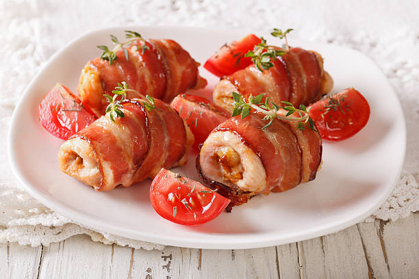 Delicious Chicken rolls with cheese and bacon close-up. horizontal stock photo