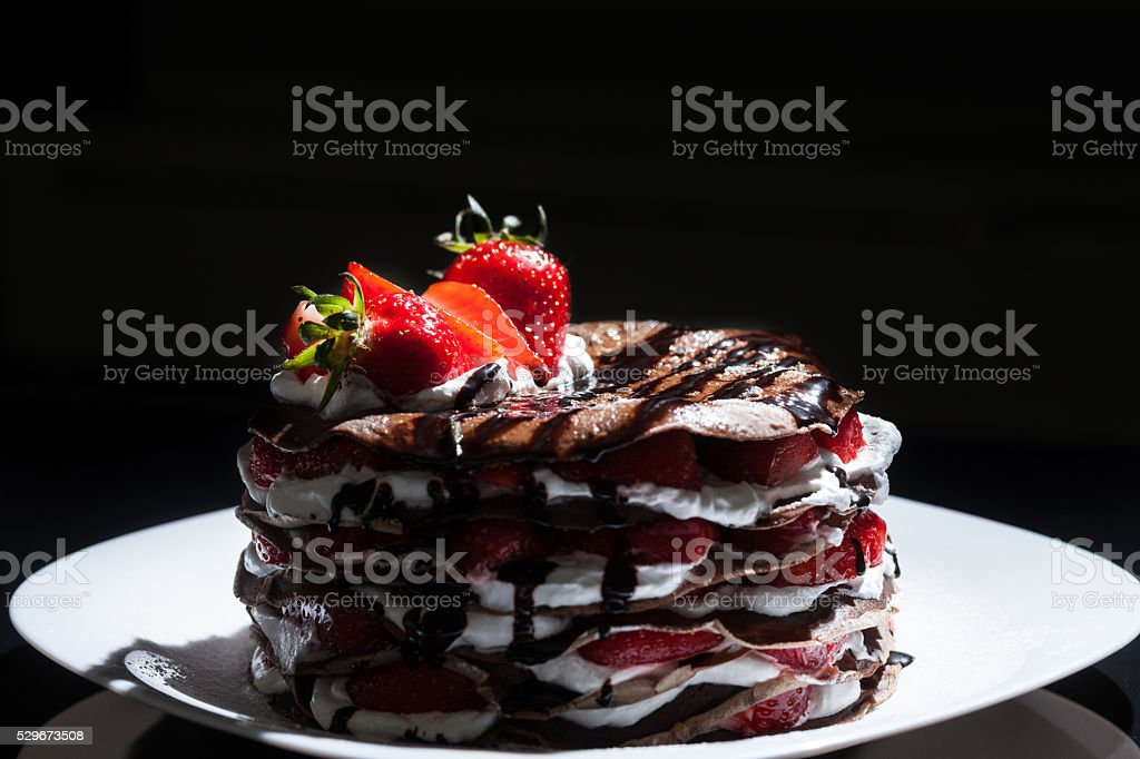 Delicious chocolate and white cream layered cake decorated with stock photo