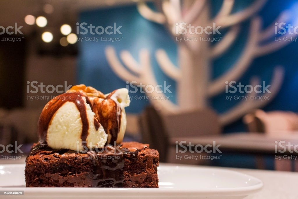 Delicious chocolate brownie with vanilla ice-cream stock photo