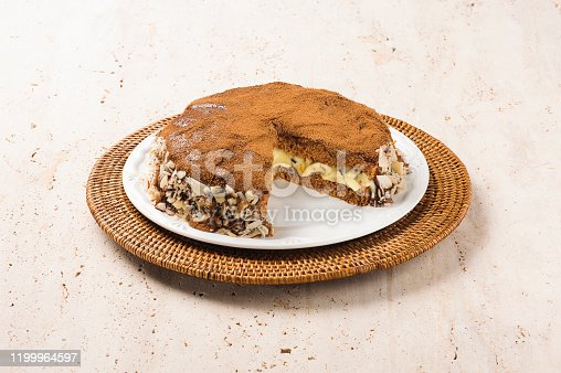 A delicious sliced chocolate cake, with white chocolate filling and chocolate and coconut topping