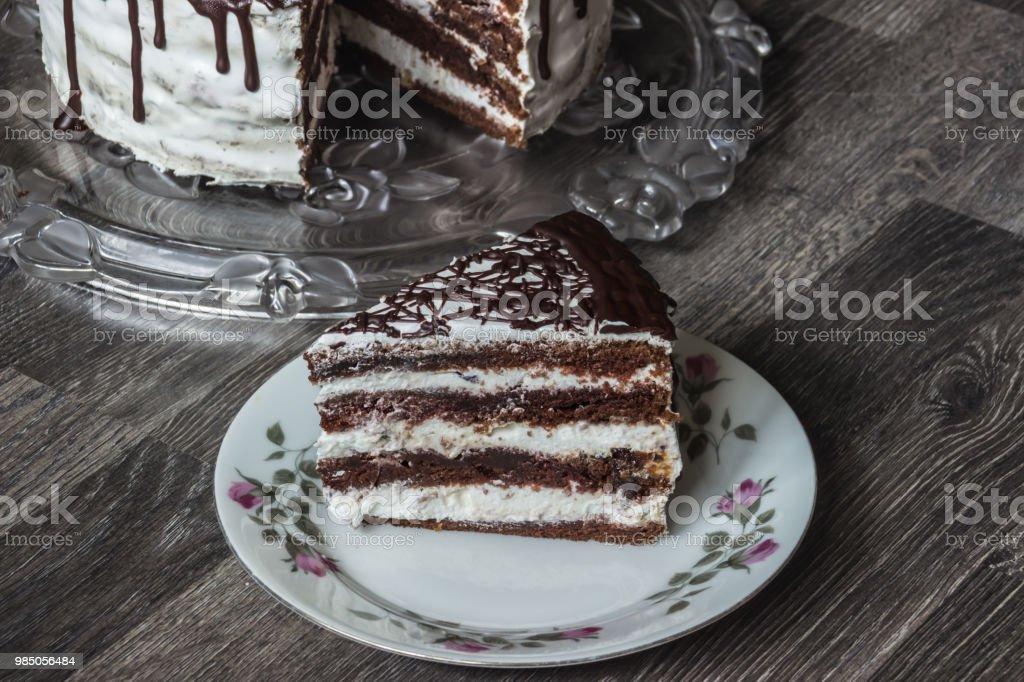 Delicious chocolate cake with creamy cream stock photo