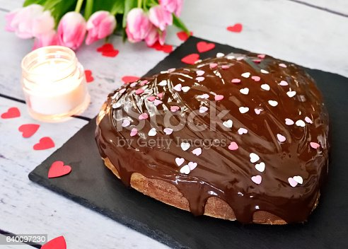 istock Delicious chocolate cake with heart shape decoration 640097230