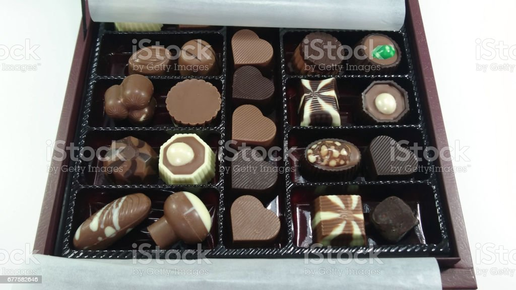 Delicious chocolate candies in gift box isolated on white royalty-free stock photo
