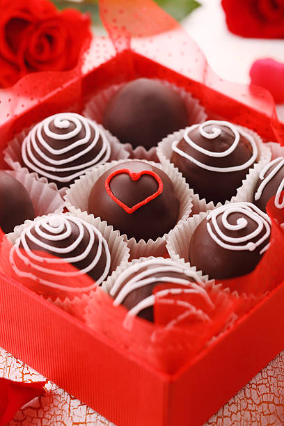 Delicious chocolate pralines  in red box for Valentine's Day, stock photo