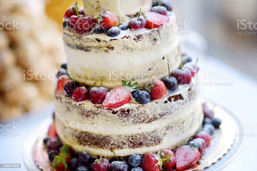 Delicious Chocolate Wedding Cake Decorated With Fruits And Berries Stock Photo Download Image Now Istock