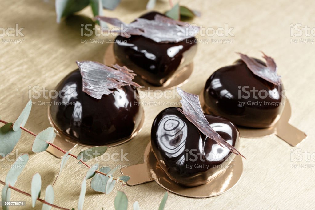 Delicious chocolates cakes. Glossy glaze and chocolate decor. Four different forms. dessert pie for sale at the shop. Delicious chocolates cakes. Glossy glaze and chocolate decor. Different forms. dessert pie for sale at the shop Baked Stock Photo