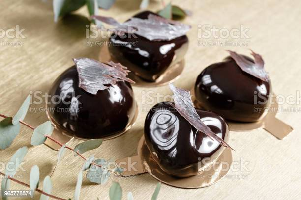 Delicious Chocolates Cakes Glossy Glaze And Chocolate Decor Four Different Forms Dessert Pie For Sale At The Shop Stock Photo - Download Image Now