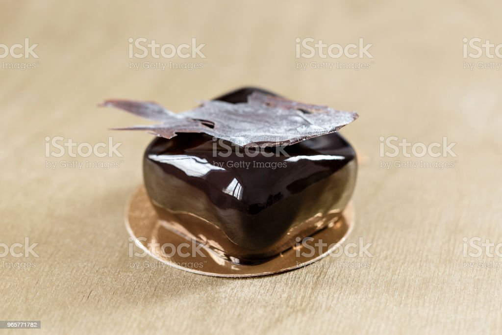 Delicious chocolates cakes. Glossy glaze and chocolate decor. small square. dessert pie for sale at the shop. - Royalty-free Baked Stock Photo