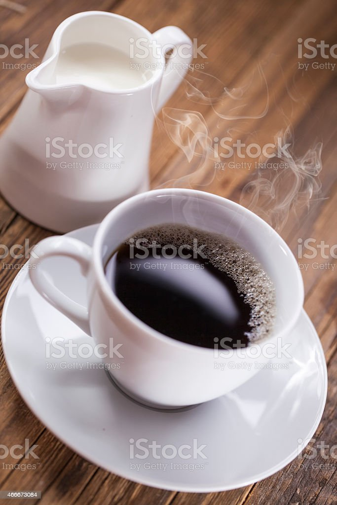 Delicious coffee with sweets on a wooden table stock photo