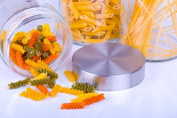 Delicious Colorful Pasta in Glass Jar on white stock photo