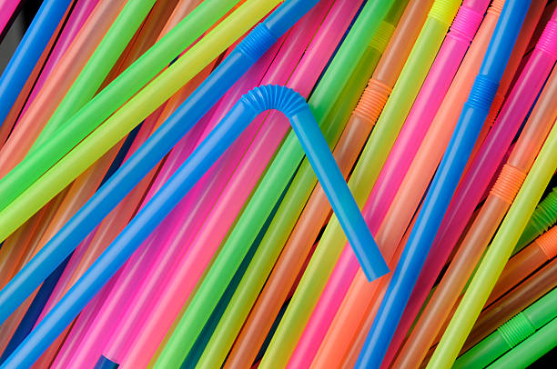 Delicious Colorful Plastic Drinking Straws; Bendable, Flexible, Disposable, Rainbow Colors stock photo