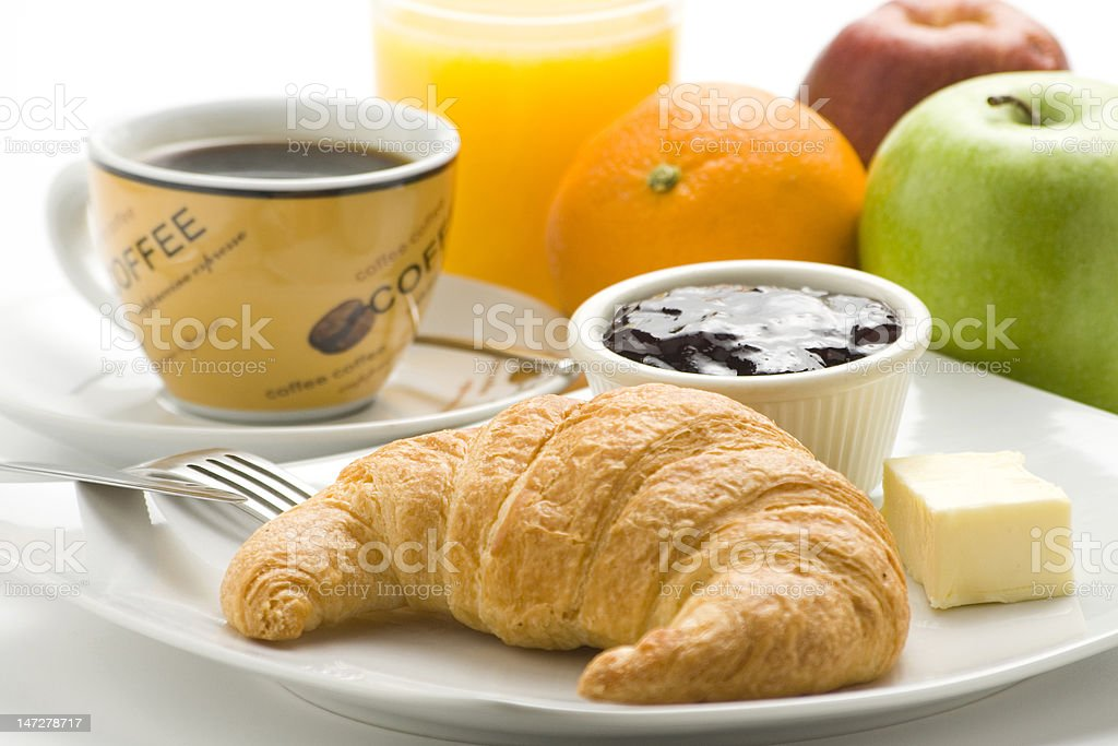 delicious continental breakfast of coffee and croissants royalty-free stock photo