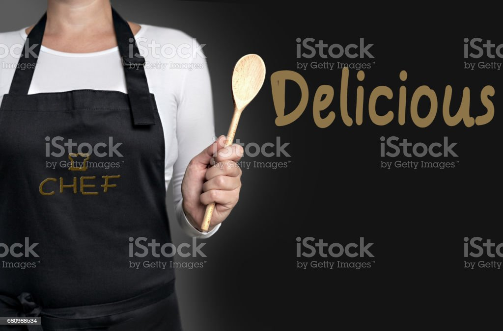 Delicious cook holding wooden spoon background concept royalty-free stock photo