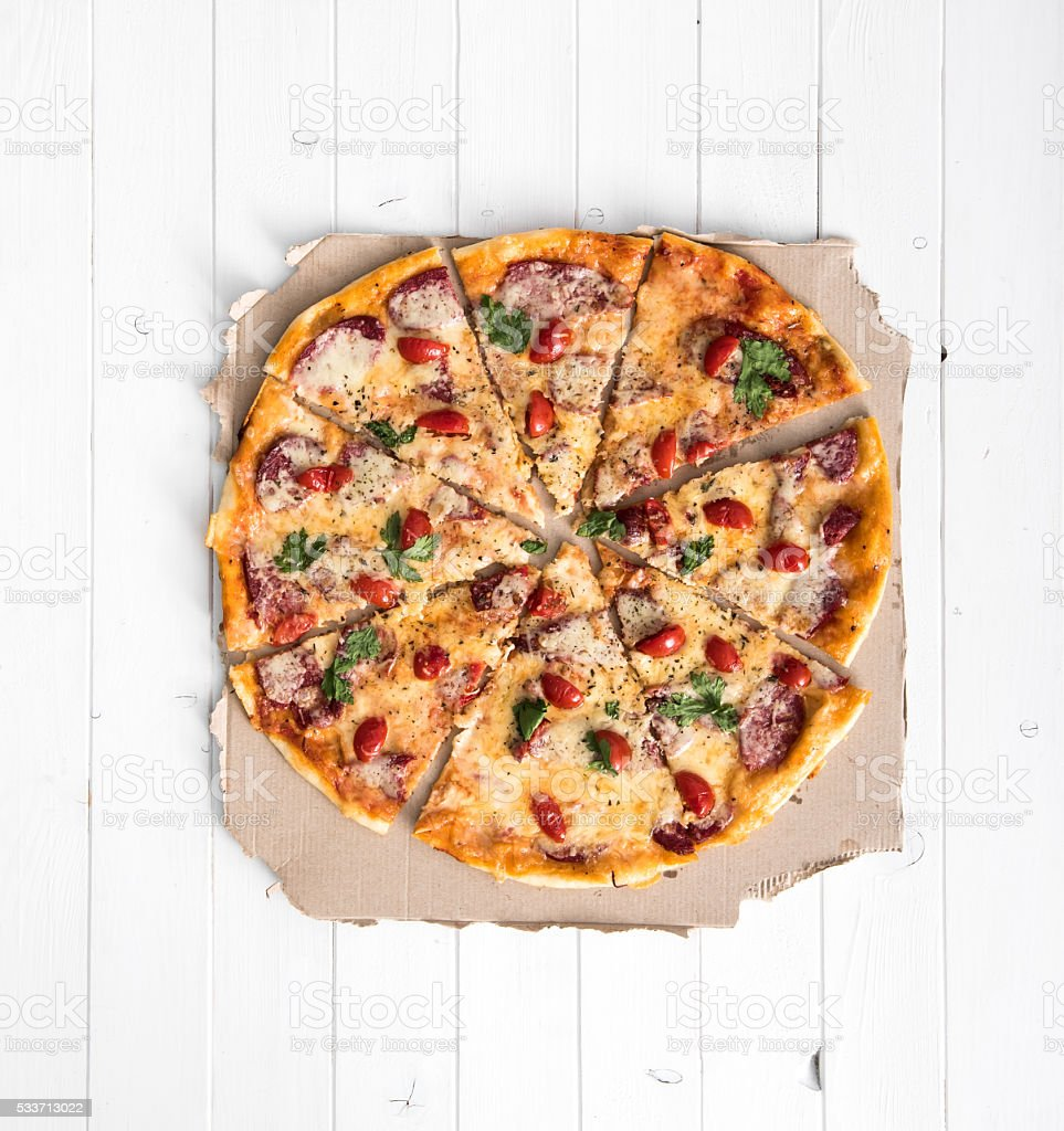 delicious cooked pizza top view stock photo