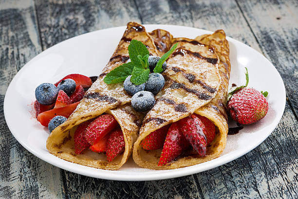 delicious crepes with berries and chocolate sauce - crepe bildbanksfoton och bilder